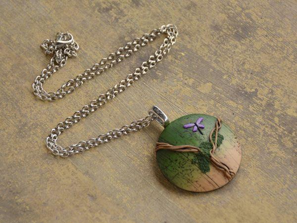Medaljon na ogrlici z ovijalko